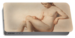 Study Of A Nude Portable Battery Charger