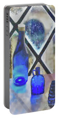Study Of Light On Cobalt Bottles Portable Battery Charger