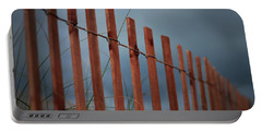 Portable Battery Charger featuring the photograph Summer Storm Beach Fence by Laura Fasulo
