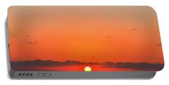 Sun Balancing On The Horizon Portable Battery Charger