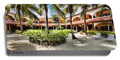 Portable Battery Charger featuring the photograph Sun Breeze Hotel by Lawrence Burry