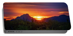 Portable Battery Charger featuring the photograph Sun Setting On Red Mountain  by Saija Lehtonen