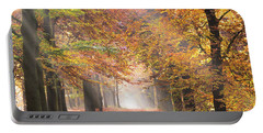 Sunbeams In A Forest In Autumn Portable Battery Charger