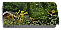 Portable Battery Charger featuring the photograph Sunflowers At The Good Earth Market by Kim Bemis