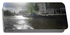 Portable Battery Charger featuring the photograph Sunlight On Canal In Amsterdam by Therese Alcorn
