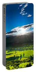 Sunrays Flood Farmland During Sunset Portable Battery Charger