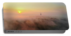 Portable Battery Charger featuring the photograph Sunrise And Morning Fog Warm Orange Light by Matthias Hauser