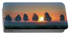 Portable Battery Charger featuring the photograph Sunrise Behind The Cedars by Lori Coleman