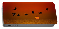 Sunrise Flight Portable Battery Charger by Steve Gadomski