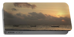 Sunrise On The Beach With Wooden Dhows Portable Battery Charger