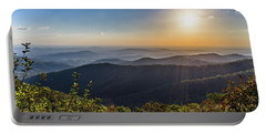 Portable Battery Charger featuring the photograph Sunrise Over The Misty Mountains by Lori Coleman