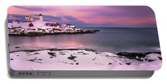 Sunset At Nubble Lighthouse In Maine In Winter Snow Portable Battery Charger