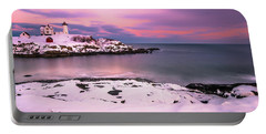 Portable Battery Charger featuring the photograph Sunset At Nubble Lighthouse In Maine In Winter Snow by Ranjay Mitra