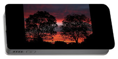 Sunset Behind Two Trees Portable Battery Charger