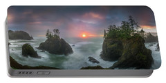 Portable Battery Charger featuring the photograph Sunset Between Sea Stacks With Trees Of Oregon Coast by William Lee