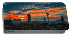 Portable Battery Charger featuring the photograph Sunset In Berlin by Pravine Chester
