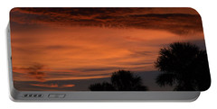 Sunset On The 4'th Portable Battery Charger by Warren Thompson