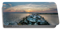 Sunset Over A Rock Jetty On The Chesapeake Bay Portable Battery Charger
