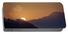 Portable Battery Charger featuring the photograph Sunset Over Asia  by Rikk Flohr