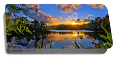 Portable Battery Charger featuring the photograph Sunset Over Hidden Lake In Jupiter Florida by Justin Kelefas