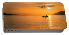 Sunset Over The Sea With Fishing Boat Portable Battery Charger by Lana Enderle