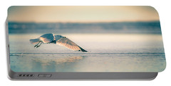 Portable Battery Charger featuring the photograph Sunset Seagull Takeoffs by T Brian Jones