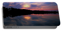Portable Battery Charger featuring the photograph Sunset Swirl by Steve Stuller
