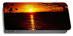 Sunset Through The Trees Portable Battery Charger by Mike Murdock
