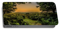 Portable Battery Charger featuring the photograph Sunset Through Trees by Nick Bywater