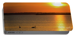 Portable Battery Charger featuring the photograph Sunset With Swan Silhouettes by Kennerth and Birgitta Kullman