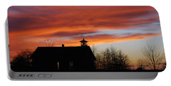 Sunsetting Behind The Historic Schoolhouse. Portable Battery Charger
