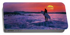 Surfer On Rock Looking Out From Blowing Rocks Preserve On Jupiter Island Portable Battery Charger by Justin Kelefas