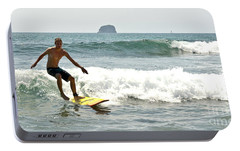 Portable Battery Charger featuring the photograph Surfing New Zealand Waves by Yurix Sardinelly