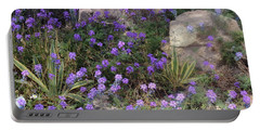 Surrounded By Purple Flowers Portable Battery Charger