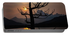 Portable Battery Charger featuring the photograph Swiftcurrent Sunset by Lon Dittrick