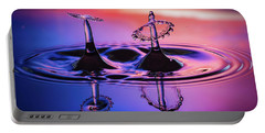 Synchronized Liquid Art Portable Battery Charger by William Lee