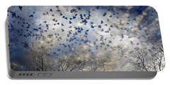Portable Battery Charger featuring the photograph Taken Flight by Jan Amiss Photography