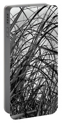 Portable Battery Charger featuring the photograph Tangled Grass by Susan Capuano