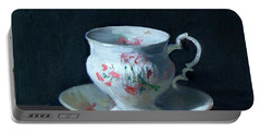 Teacup And Saucer On Dark Background Portable Battery Charger