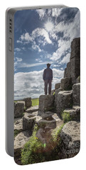 Portable Battery Charger featuring the photograph Teen Boy Standing On Basalt Rocks by Edward Fielding