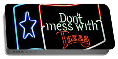 Portable Battery Charger featuring the photograph Texas Flag Saloon Neon by Daniel Hagerman