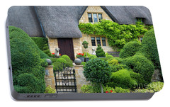Portable Battery Charger featuring the photograph Thatch Roof Cottage Home by Brian Jannsen