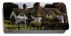 Portable Battery Charger featuring the photograph Thatched Cottage by Baggieoldboy