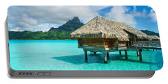 Portable Battery Charger featuring the photograph Thatched Roof Honeymoon Bungalow On Bora Bora by IPics Photography