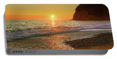 the beach and the Mediterranean sea in Montenegro in the summer at sunset Portable Battery Charger
