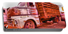 Portable Battery Charger featuring the photograph The Beauty Of An Old Truck by Jeff Swan