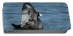 Portable Battery Charger featuring the photograph The Big Flap by Fraida Gutovich
