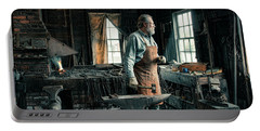 Portable Battery Charger featuring the photograph The Blacksmith - Smith by Gary Heller