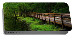 Portable Battery Charger featuring the photograph The Bridge At Wolfe Park by Karol Livote
