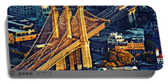 Portable Battery Charger featuring the photograph The Brooklyn Bridge At Sunset   by Sarah Loft